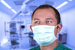 Surgeon in operating room. With mask Stock Image