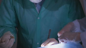 Surgeon During operation. Surgeon`s hands during operation. Close up. surgical teamwork,surgeon`s hands stock footage