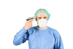 Surgeon planning to suicide, gun on his head eyes closed isolated on white Stock Image