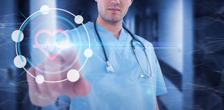 Composite image of surgeon pretending to be using futuristic digital screen Royalty Free Stock Image