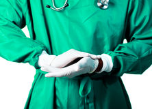 Surgeon putting on his gloves Royalty Free Stock Image