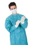 Surgeon putting on surgical gloves Stock Photography