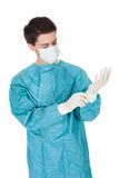 Surgeon putting on surgical gloves Stock Image