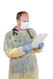 Surgeon reading clipboard. Isolated Surgeon reading clipboard on white background Royalty Free Stock Image