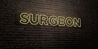 SURGEON -Realistic Neon Sign on Brick Wall background - 3D rendered royalty free stock image. Can be used for online banner ads and direct mailers Royalty Free Stock Photos