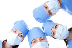 Surgeon's heads together making circle stock photos
