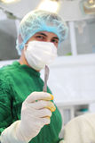 Surgeon with scalpel Royalty Free Stock Images