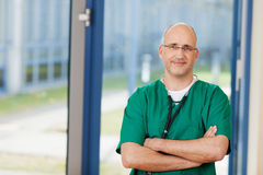 Surgeon In Scrubs With Arms Crossed Standing In Clinic Stock Photography