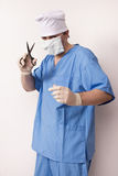 Surgeon in scrubs with scissor Stock Photos