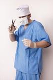 Surgeon in scrubs with scissor Stock Photos