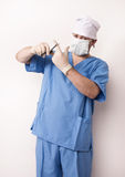 Surgeon in scrubs with scissor Royalty Free Stock Photo