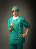 Surgeon showing rude gesture Stock Image