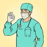 Surgeon shows ok sign pop art style vector Royalty Free Stock Photography