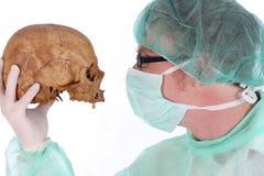 Surgeon with skull stock photo