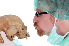 Surgeon with skull Royalty Free Stock Image