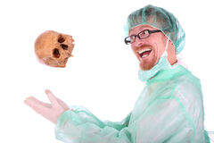 Surgeon with skull Royalty Free Stock Photo
