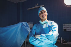 Surgeon standing with arms crossed in operation room. At the hospital Stock Image