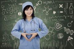 Surgeon student makes heart symbol Stock Photos