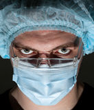 Surgeon in surgical mask. Portrait of sweat serious surgeon in surgical mask royalty free stock image