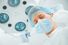 Surgeon takes off his mask Stock Photography