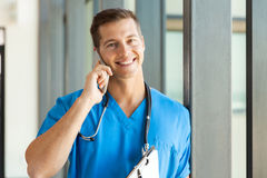 Surgeon talking cell phone Stock Images