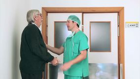 Surgeon talking in the corridor Stock Photo