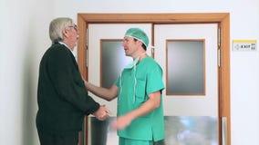 Surgeon talking in the corridor Stock Photo
