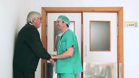 Surgeon talking in the corridor Stock Images