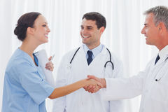 Surgeon thanking the doctor for helping her Stock Images