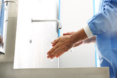Surgeon washing hands. The doctor washes his hands, disinfect their hands before surgery stock image