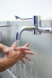 Surgeon washing hands prior to operation Stock Photo