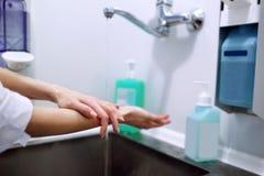 Surgeon washing hands stock photography
