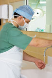 Surgeon Washing his Hands in Operating Room Stock Images