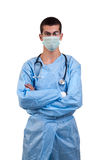 Surgeon wearing blue scrubs with arms crossed Stock Photos