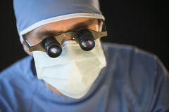 Surgeon Wearing Mask And Magnifying Glasses Stock Photography
