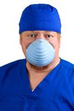 Surgeon Wearing Surgical Mask. Surgeon in blue scrubs wears a surgical mask to prevent the spread of germs Stock Photo