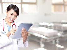 Surgeon woman doctor using tablet pc Stock Photos