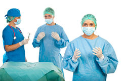Surgeon woman and her team stock photography