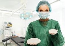 Surgeon woman holding silicon breast implants Royalty Free Stock Images
