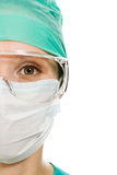 Surgeon woman in protective glasses and mask royalty free stock photography