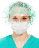 Surgeon woman in protective glasses and mask Stock Image