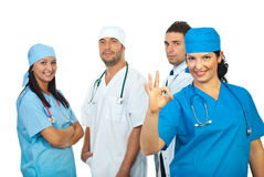 Surgeon woman showing okay sign Stock Images