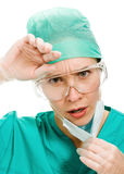 Surgeon woman sighs wearily Royalty Free Stock Image