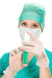Surgeon woman with syringe making injection,. On a white background Royalty Free Stock Images