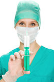 Surgeon woman with syringe making injection,. On a white background Stock Photo