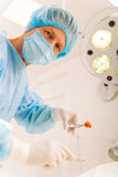 Surgeon at work Stock Images