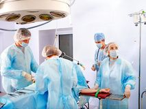 Surgeon at work in operating room. stock photos