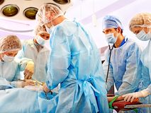 Surgeon at work in operating room. Royalty Free Stock Images