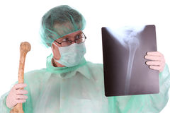 Surgeon with xray and bone. Details surgeon with xray and bone on white background Stock Image