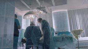 Surgeons are busy with performing the operation stock video